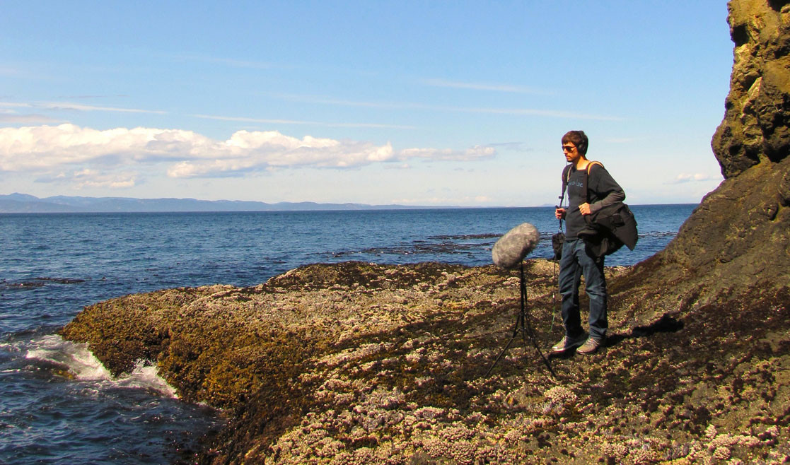 Field Recordist Eric Mooney recording ocean sounds at olympic national park