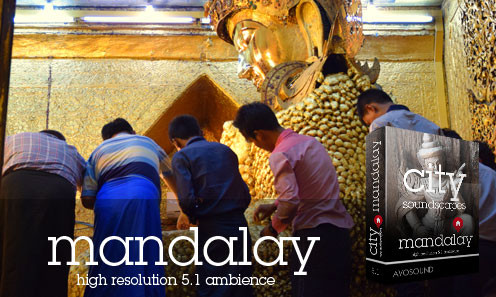 Mahamuni Statue in Mandalay - Believers apply leaf gold