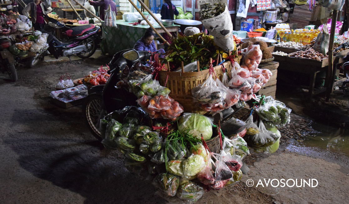 Hsipaw night market with fully laden moped