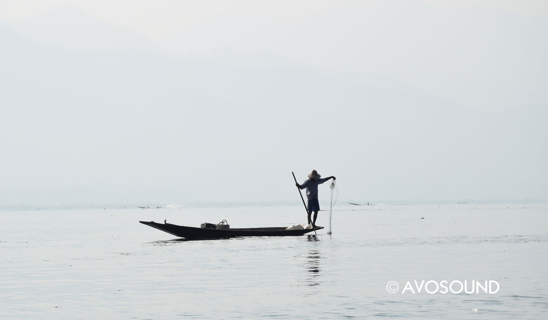 Myanmar Travel Log - A fisherman in his boat on the Inle lake