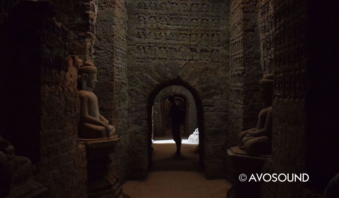 Temple interior: dark but cool hallways decorated with thousands of buddha figures