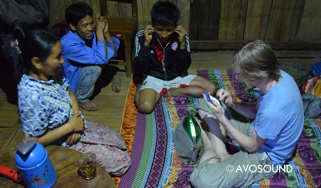 Listening to sound recordings with Burmese locals - Jungle trekking in Hsipaw