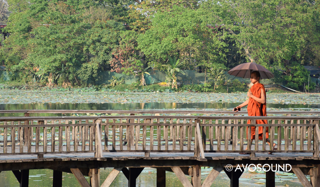 Myanmar Travel Log A monk on a wooden bridge in Yangon